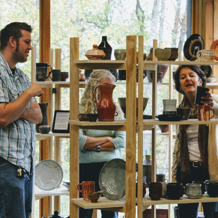 Shoppers browsing locally crafted ceramics at the Oakdale Art Discovery Fair