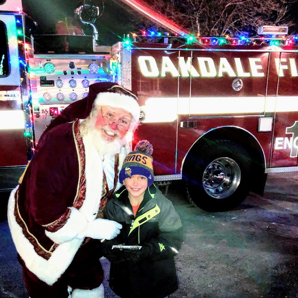 Santa posing for a picture with a Oakdale resident