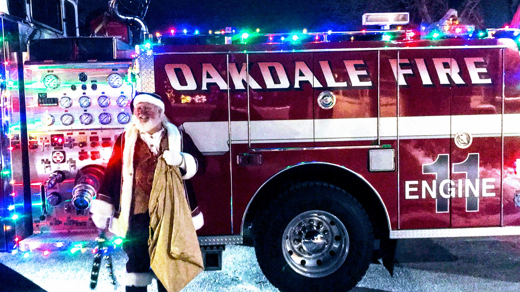 Santa Stands by a Firetruck
