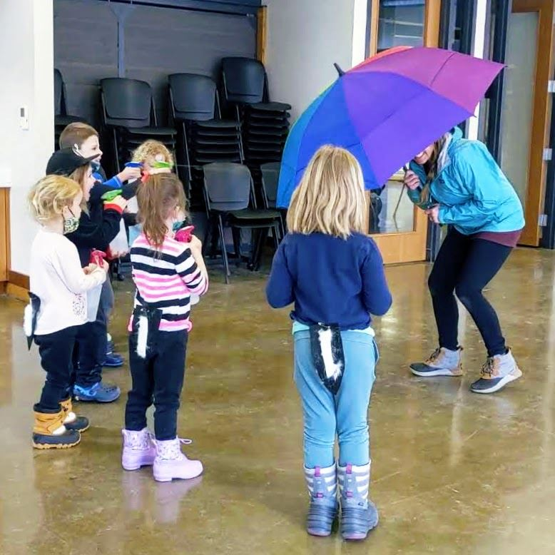 Two children are coloring pages together